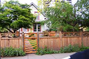 Victoria Home w wood fence