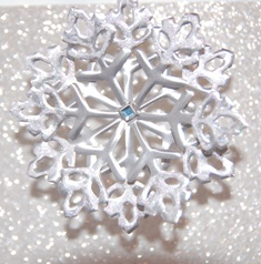 Snowflake in tin