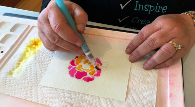 Close up of flower being painted